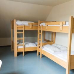 Schlafzimmer im deutschen Ferienhaus für Gruppen Schotten.