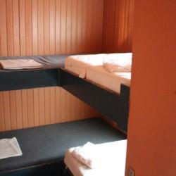 Etagenbetten im dänischen Gruppenhaus Tydal für Kinder und Jugendfreizeiten.